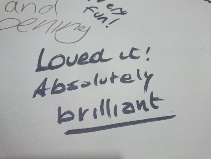Flipchart paper showing participants' feedback - 'Loved it! Absolutely brilliant'